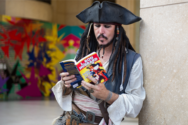 "Pirate reading ""Under the Black Ensign"""