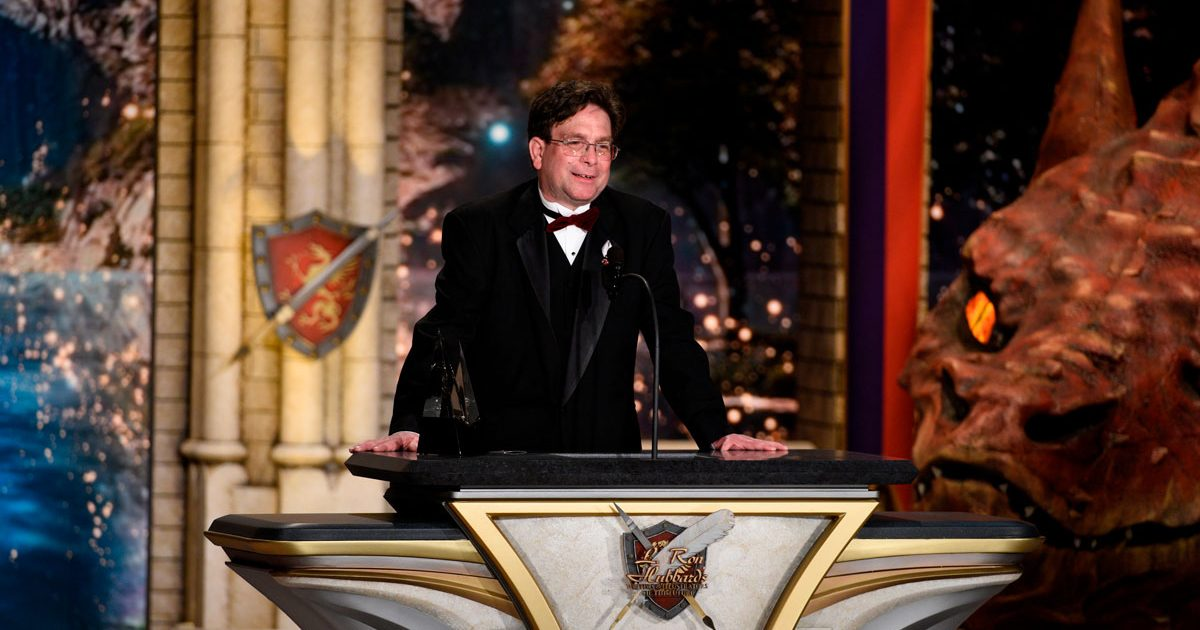 Andrew L. Roberts on stage at the Wilshire Ebell Theatre, accepting his award