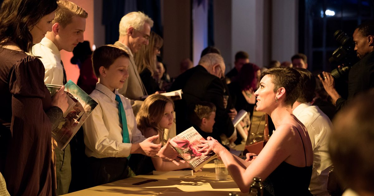 Molly Elizabeth Akins signing books after the awards ceremony