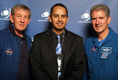 Diego Martinez with astronauts Capt. Michael J. McCulley and Col. Michael Good