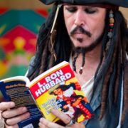 """Pirate reading """"Under the Black Ensign"""""""