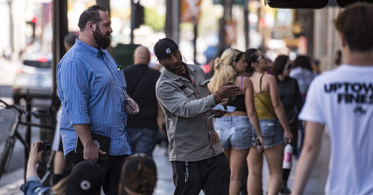 Jake talking to a stranger on Hollywood Blvd.