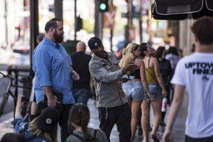 Jake talking to a stranger on Hollywood Blvd.