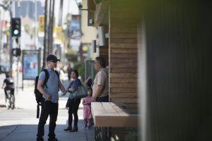 Stephen Lawson speaking with a stranger.
