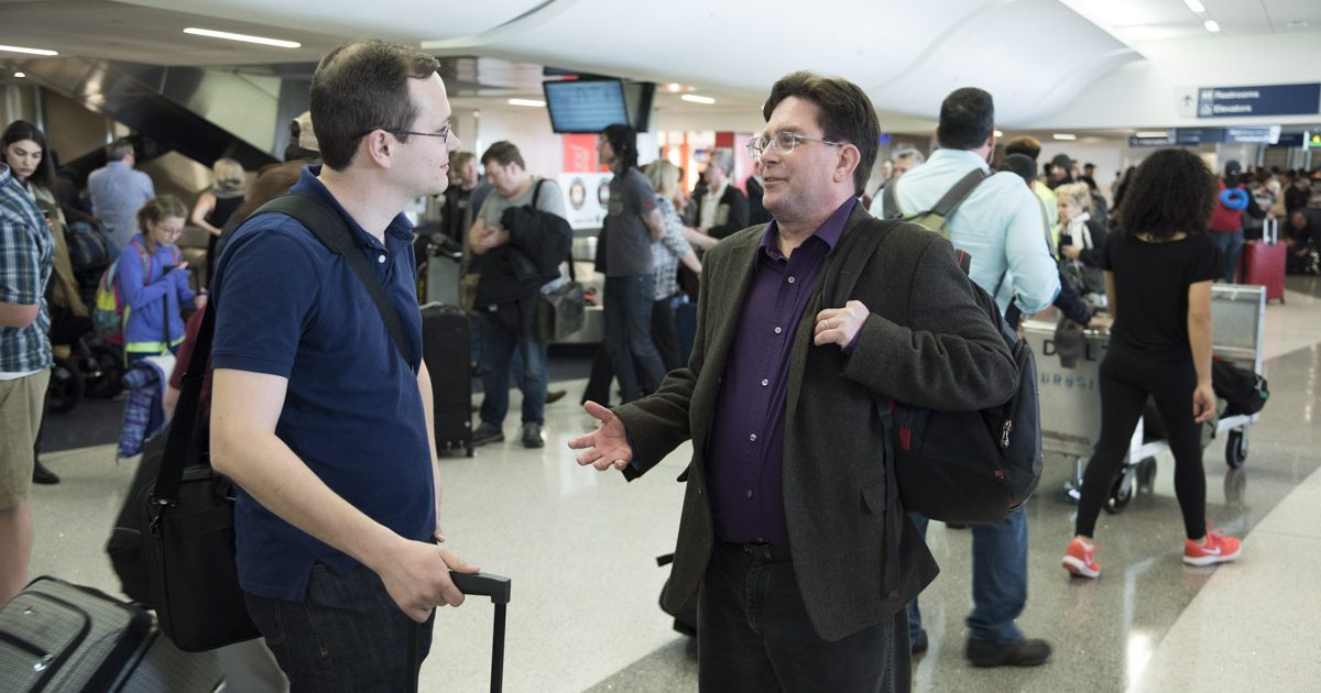 Dustin and Andrew meeting at the airport