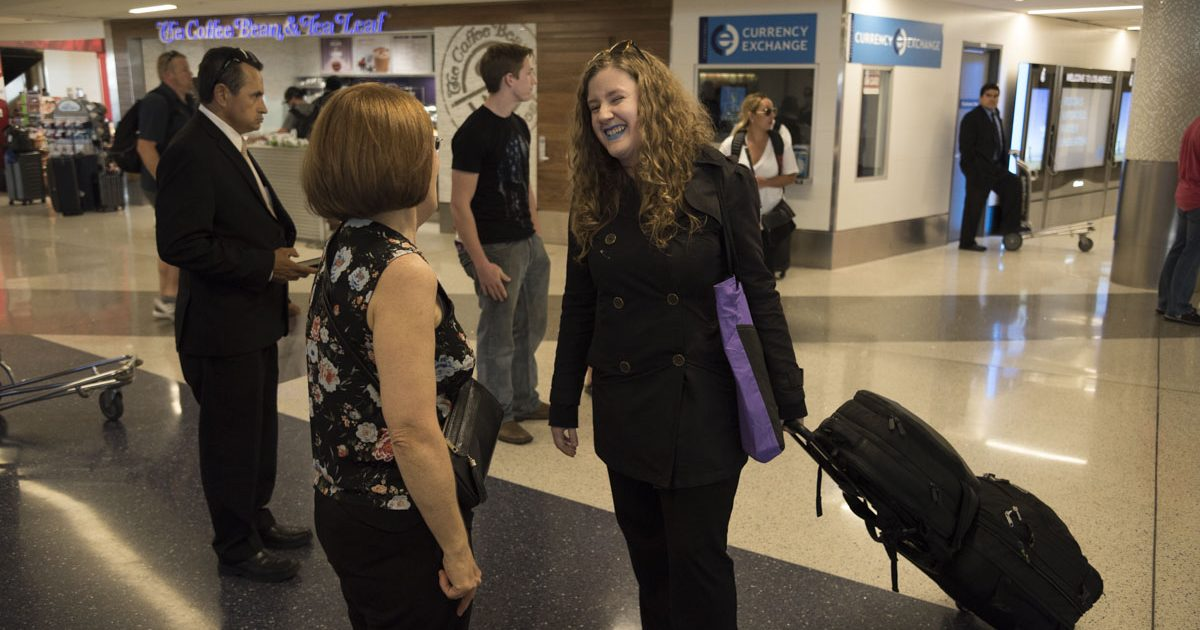 Clare Kagmi being greeted at the airport