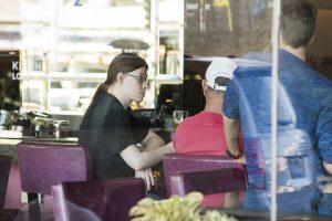 Ville Merilainen multi-tasking while talking with a stranger.