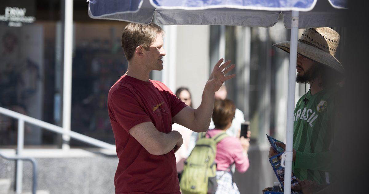 David VonAllmen talking with a stranger.