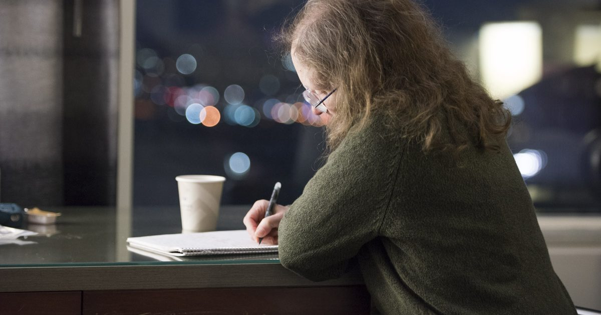 Ziporah Hildebrandt writing away.