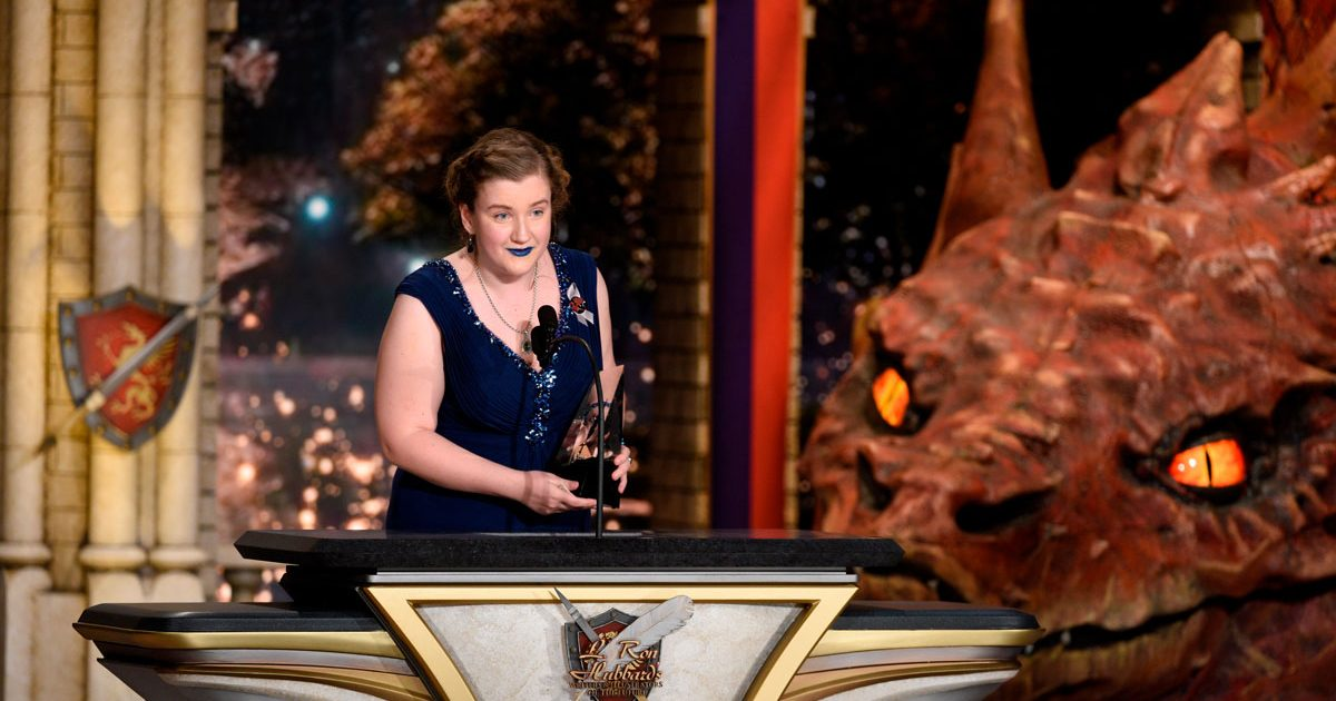 C.L. Kagmin on stage accepting her award