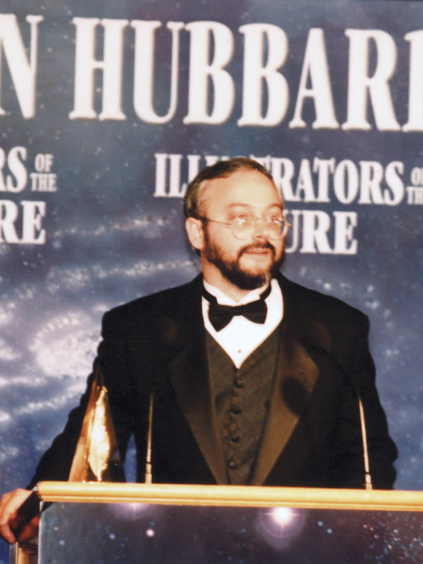 Scott Nicholson on stage accepting his Golden Pen Award in 1999