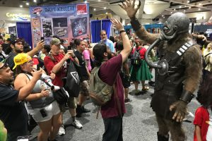 Fans taking pictures of Terl at SDCC.
