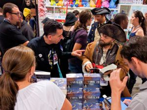 Fans at Dragon Con getting their copy of Battlefield Earth