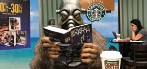 Terl reading his favorite book, Battlefield Earth