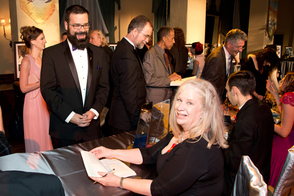 Sharon signing a copy of her story for William Pomerantz, VP Special Projects at Virgin Galactic