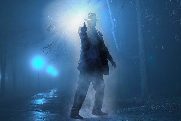 Image of a detective on the street at night aiming his gun