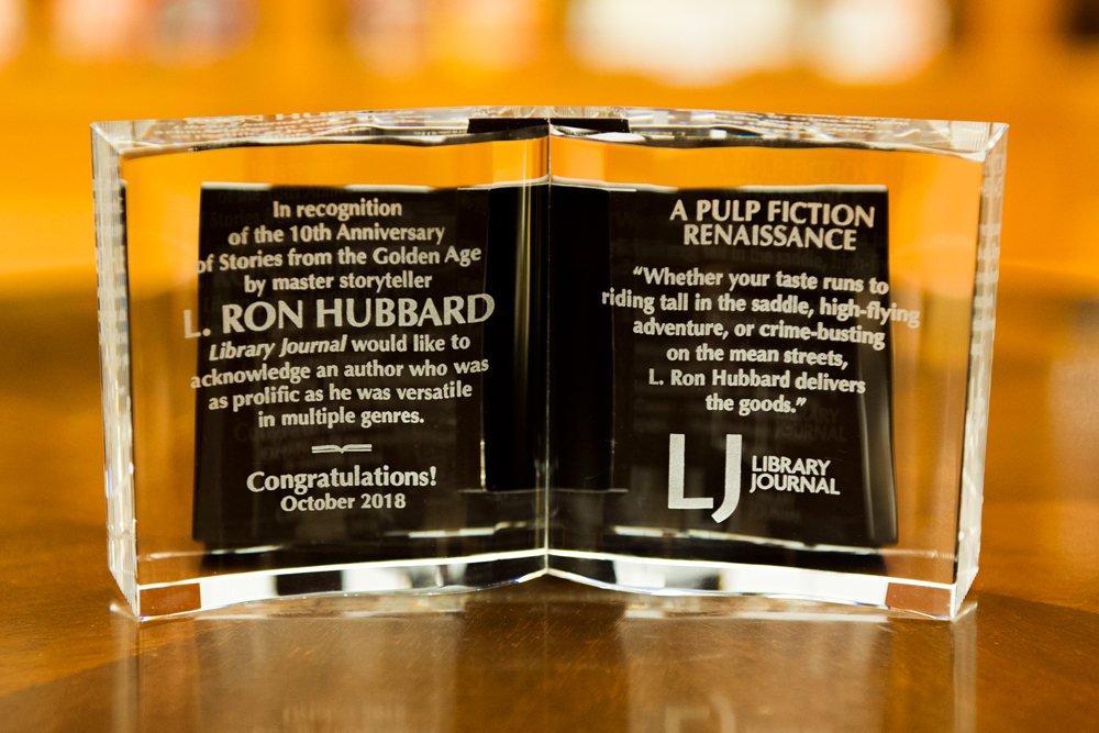 Library Journal Magazine honors L. Ron Hubbard with crystal book on the 10th-anniversary of the Stories from the Golden Age