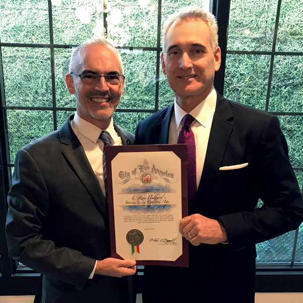LA City Council Member Mitch O'Farrell presenting Certificate of Recognition to President Galaxy Press John Goodwin for forwarding the arts with the 80 volume line of books and audiobooks and over 300 live performances in Hollywood.