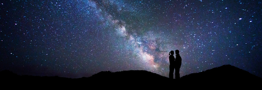 Couple against the stars