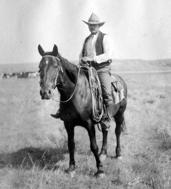 cowboy on a horse, circa 1910